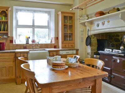 welcoming country kitchen in large house